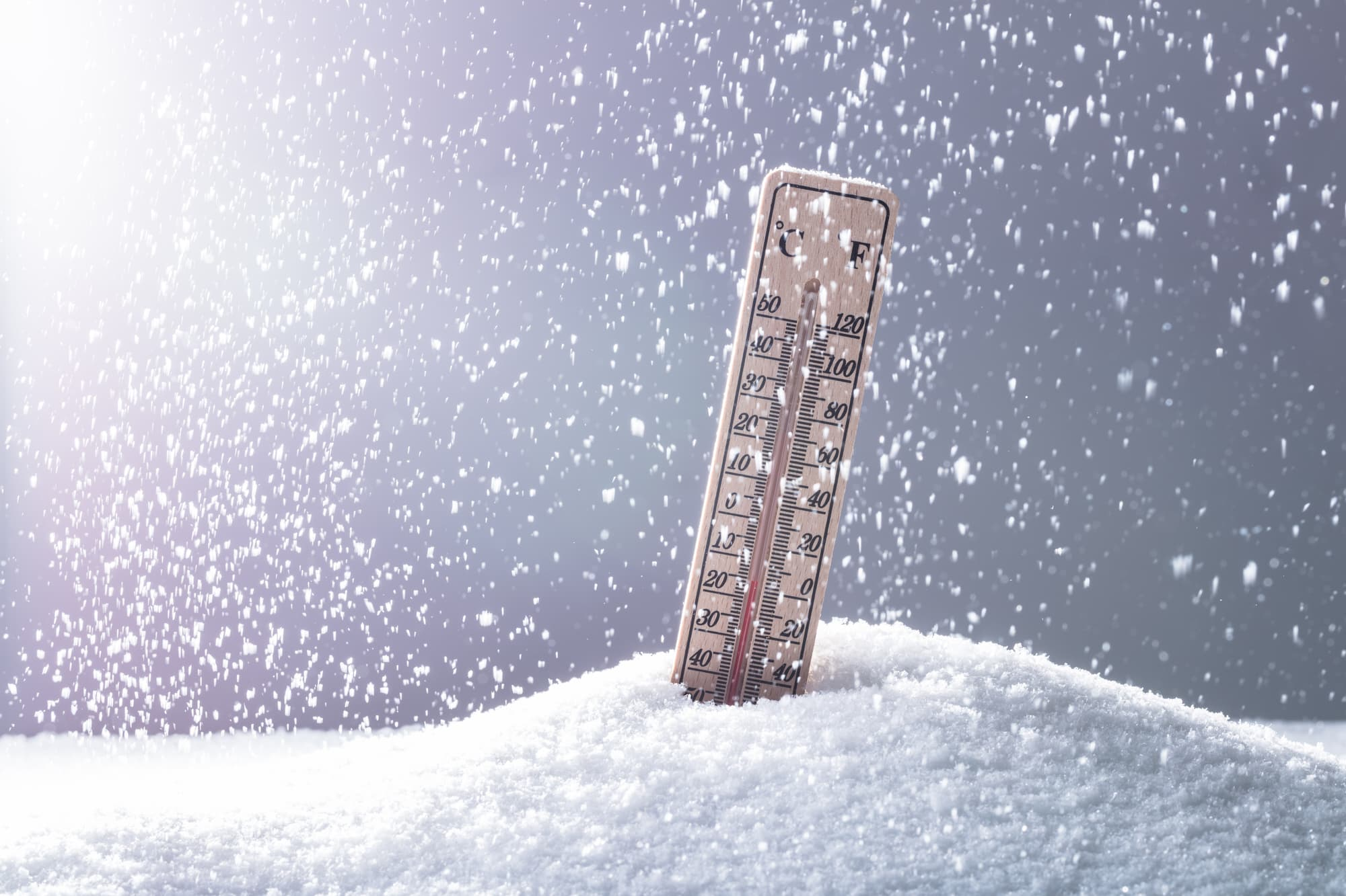 Thermometer On Snow Showing Low Temperature